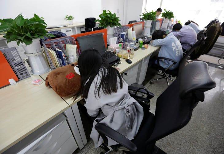 "Employees at Goopal Group take a nap in their seats after lunch, in Beijing, China, April 21, 2016. Office workers sleeping on the job is a common sight in China, where a surplus of cheap labour can lead to downtime at work. But in China's technology sector, where business is growing faster than many start-up firms can hire new staff, workers burn the midnight oil to meet deadlines and compete with their rivals. Some companies provide sleeping areas and beds for workers to rest during late nights. REUTERS/Jason Lee       SEARCH ""JASON SLEEP"" FOR THIS STORY. SEARCH ""THE WIDER IMAGE"" FOR ALL STORIES   - RTX2DQ8X"