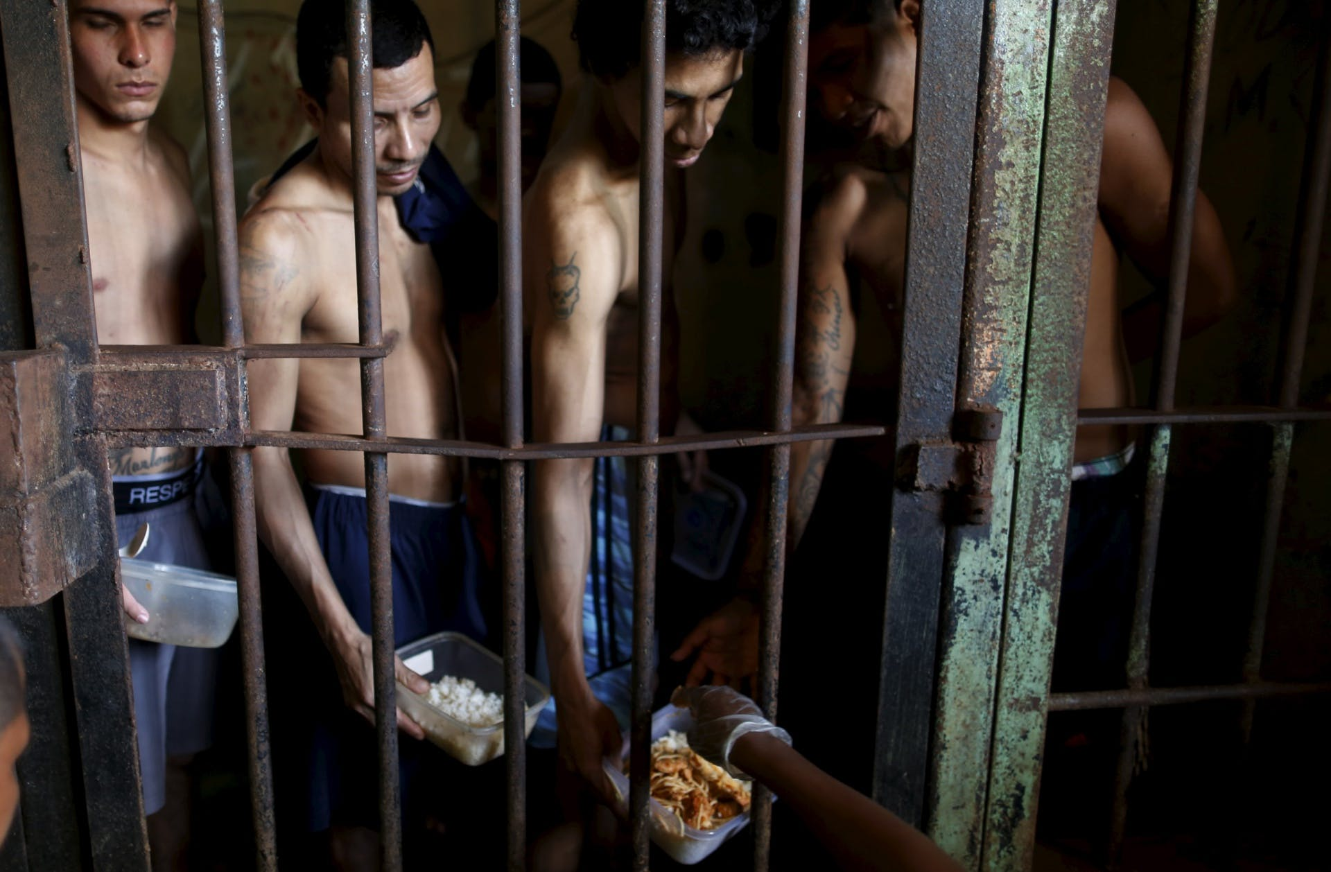 """Inmates line up for food provided by the prison in Pavilion No.2 in La Joya prison on the outskirts of Panama City, Panama January 27, 2016. Inmates of La Joya prison on the outskirts of Panama City are housed in makeshift cells amid heavy overcrowding, living in grimy conditions and with limited medical attention. Many prisoners in the Central American nation languish for years without being sentenced.  REUTERS/Carlos Jasso SEARCH """"PANAMA PRISON"""" FOR THIS STORY. SEARCH """"THE WIDER IMAGE"""" FOR ALL STORIES       TPX IMAGES OF THE DAY      - RTX29RCO"""