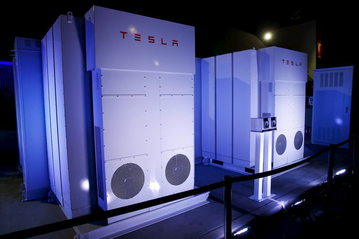 Tesla Energy batteries for businesses and utility companies are pictured providing energy for the Tesla Motors Powerwall Home Battery event in Hawthorne, California April 30, 2015. Tesla Motors Inc unveiled Tesla Energy - a suite of batteries for homes, businesses and utilities - a highly-anticipated plan to expand its business beyond electric vehicles. REUTERS/Patrick T. Fallon - RTX1B285