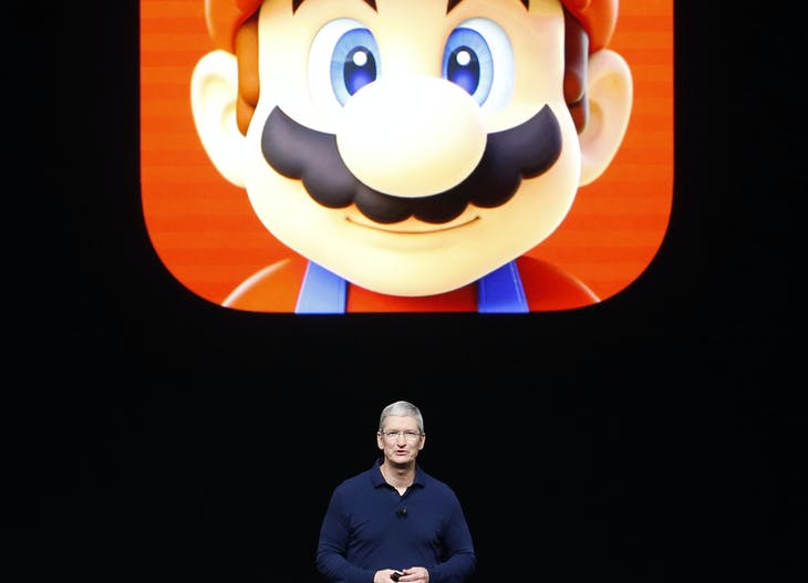Apple Inc CEO Tim Cook speaks in front of a Mario Bros. image during an Apple media event in San Francisco, California, U.S. September 7, 2016. Reuters/Beck Diefenbach - RTX2OJ60