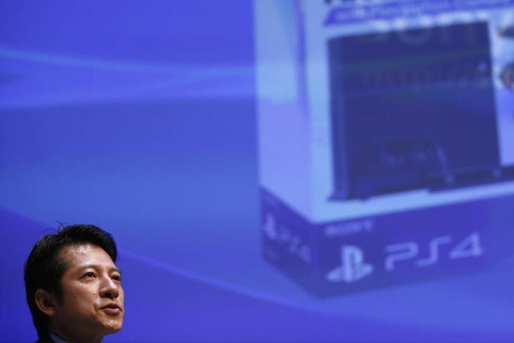 Sony Computer Entertainment Japan Asia President Hiroshi Kawano speaks during a news conference in Tokyo September 9, 2013. Sony Corp announced the Japanese release of its PlayStation 4 on Monday as the electronics maker braces for a console war with Microsoft Corp that could make or break the Japanese firm's struggle to return to profit. REUTERS/Toru Hanai (JAPAN - Tags: BUSINESS HEADSHOT SOCIETY) - RTX13DZ5