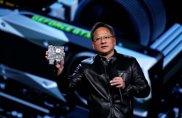 Jen-Hsun Huang, founder and CEO of Nvidia holds up a Nvidia Xavier AI car supercomputer as he speaks at his keynote address at CES in Las Vegas, January 4, 2017.  REUTERS/Rick Wilking - RTX2XL3U