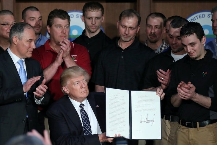 "U.S. President Donald Trump holds up an executive order on ""Energy Independence,"" eliminating Obama-era climate change regulations, during a signing c..."