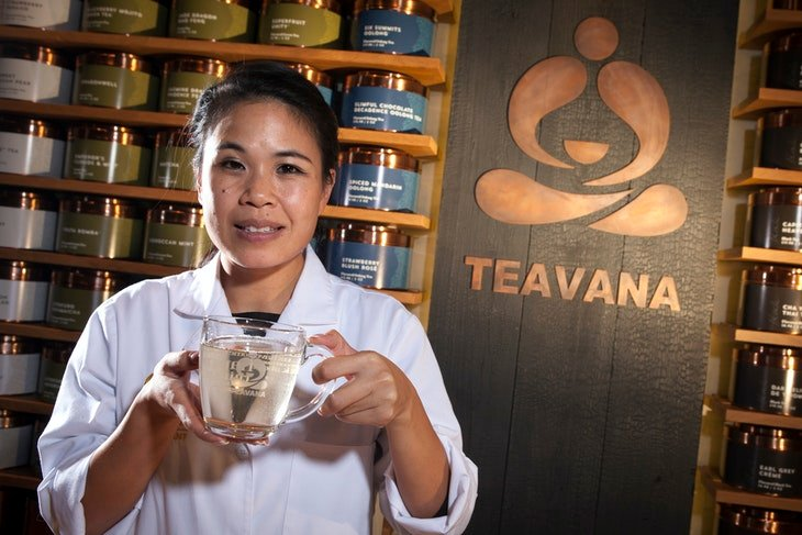 Teavana's director of tea development Tsunoda holds a cup of tea as she poses for a portrait at a Teavana store in New York