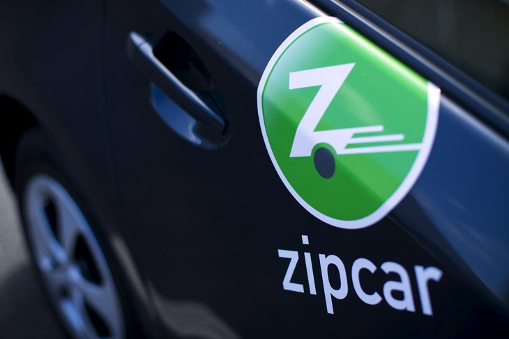 The logo on the side of a Zipcar is shown in San Diego, California