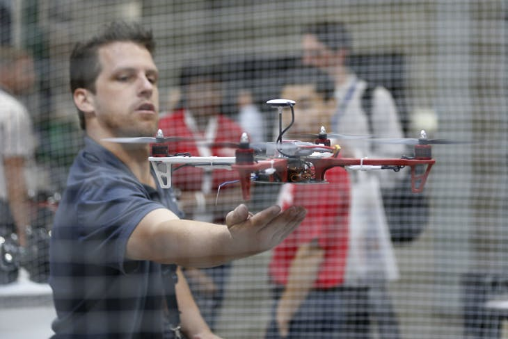 DJI innovations technician Scott Horn releases a small unmanned aerial vehicle (UAV) during a demonstration at the Association for Unmanned Vehicle Systems International exhibition in Washington, August 13, 2013. Dozens of companies are chomping at the bit for the FAA to certify their affordable drones, saying there is no way farmers and many others can invest in the type of UAVs that received certification last month.  REUTERS/Jason Reed     (UNITED STATES - Tags: SCIENCE TECHNOLOGY MILITARY) - RTX12K9X