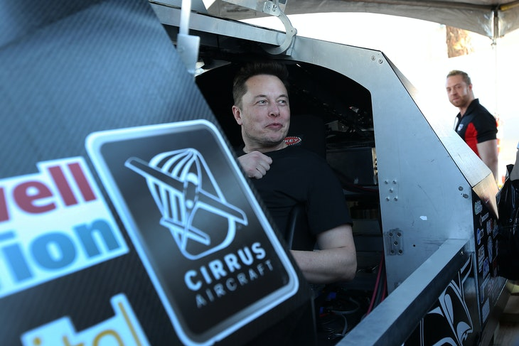Ellon Musk, founder and CEO of SpaceX sits in a pod displayed in a booth during the SpaceX Hyperloop Pod Competition in Hawthorne, Los Angeles, California, U.S., January 29, 2017. REUTERS/Monica Almeida - RC1BF8A9C0B0