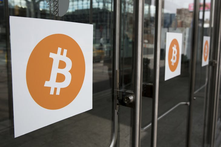Bitcoin themed stickers stand attached to glass doors during the Inside Bitcoins: The Future of Virtual Currency Conference in New York April 8, 2014. REUTERS/Lucas Jackson (UNITED STATES - Tags: BUSINESS SCIENCE TECHNOLOGY) - GM1EA490G2N01