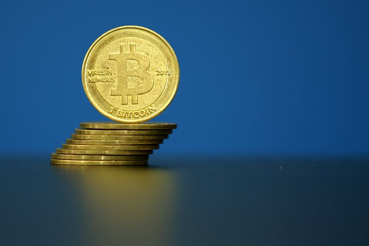 "Bitcoin (virtual currency) coins are seen in an illustration picture taken at La Maison du Bitcoin in Paris, France, May 27, 2015. British authorities have come out in support of digital currencies in the name of promoting financial innovation, while proposing that regulations should be drawn up to prevent their use in crime. But it is technophiles who are leading the drive to make London a real-world hub for trade in web-based ""cryptocurrencies"", of which bitcoin is the original and still most popular.   Picture taken May 27, 2015.  REUTERS/Benoit Tessier - PM1EB5R1DJW01"