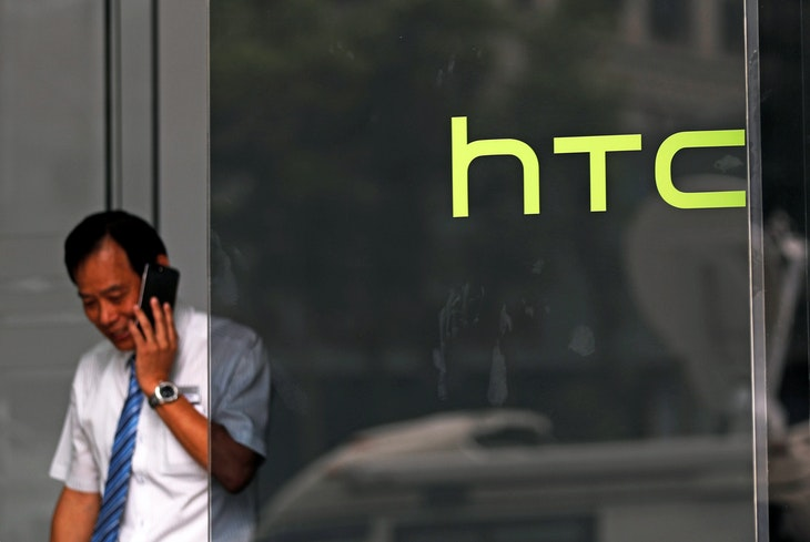 A man leaves from HTC headquarters before a news conference to announce Google to acquire HTC's Pixel smartphone division, in Taipei, Taiwan September 21, 2017. REUTERS/Tyrone Siu - RC111F687CE0