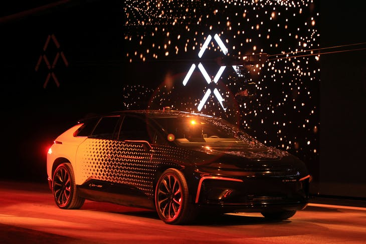 A Faraday Future FF 91 electric car arrives on stage for an exhibition of speed during an unveiling event at CES in Las Vegas, Nevada January 3, 2017. REUTERS/Steve Marcus - RC1C740ACAF0