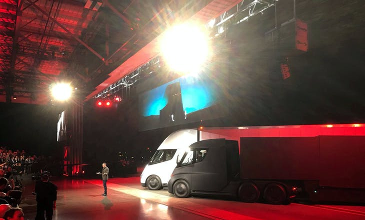 Tesla CEO Elon Musk shows off the Tesla Semi as he unveils the company's new electric semi truck during an presentation in Hawthorne, California, U.S., November 16, 2017. REUTERS/Alexandria Sage - RC174492EF10