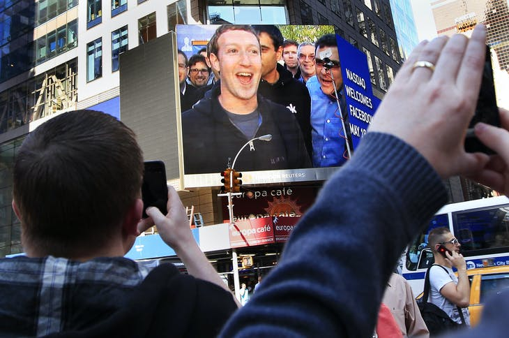 Facebook Inc. CEO Mark Zuckerberg is seen on a screen televised from their headquarters in Menlo Park moments after their IPO launch in New York May 18, 2012. Facebook Inc, began trading on the Nasdaq market on Friday, with its initial public offering at $38 a share, giving the world's No. 1 online social network a $104 billion valuation in the third largest offering in U.S. history.   REUTERS/Shannon Stapleton (UNITED STATES - Tags: BUSINESS) - GM1E85I1PE601