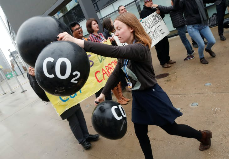 Activists protest against the carbon dioxide emissions trading in front of the World Congress Centre Bonn, the site of the COP23 U.N. Climate Change Conference, in Bonn, Germany, November 17, 2017.  REUTERS/Wolfgang Rattay - RC1B81AD0310