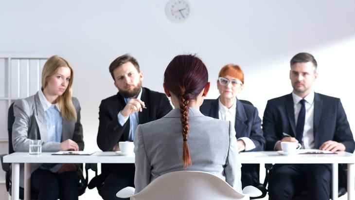 Woman during job interview and four elegant members of management; Shutterstock ID 370947476; PO: angelikiJ-for robin kawakami