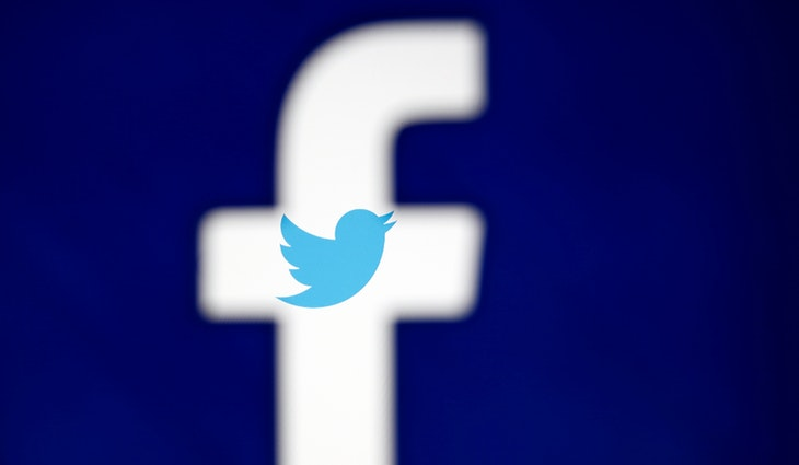 A 3D-printed Facebook logo is displayed in front of the Twitter logo, in this illustration taken October 25, 2017. REUTERS/Dado Ruvic/Illustration - RC133FDE11A0