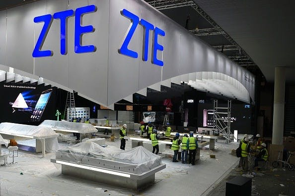 Workers prepare the ZTE Chinese company stand for the Mobile World Congress in Barcelona on February 20, 2016, before the start of the world's biggest mobile fair, held from February 22 to February 25.   The mobile phone industry professionals will meet next week in Barcelona looking for a boost, in a slowed market, that could entail 5G technology, virtual reality or any other innovation in this sector in constant transformation. / AFP / LLUIS GENE        (Photo credit should read LLUIS GENE/AFP/Getty Images)