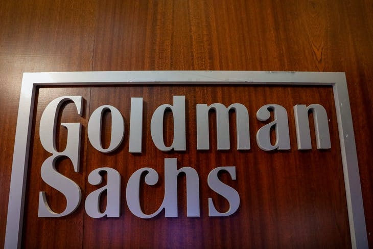 The Goldman Sachs company logo is seen in the company's space on the floor of the New York Stock Exchange, (NYSE) in New York, U.S., April 17, 2018. REUTERS/Brendan McDermid - RC1BDE36CF80