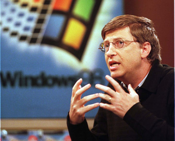 Bill Gates, Chairman and CEO of Microsoft makes a point as he talks to reporters at a CompUSA store in San Francisco, June 25. Gates talked about the new features of the Windows 98 operating system that was released today in the United States. - PBEAHUMDODT