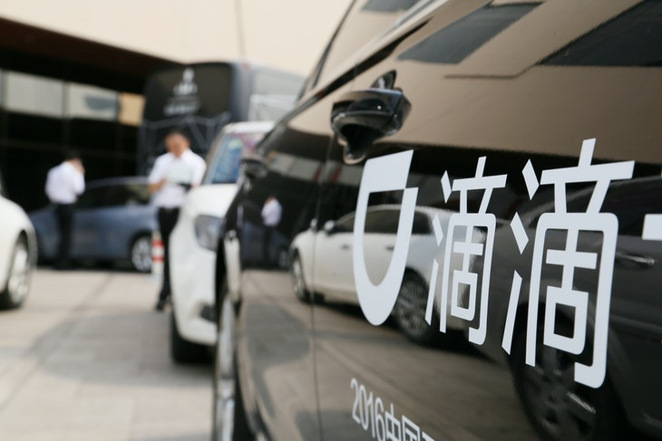A Didi sign is seen on a car during the China Internet Conference in Beijing, China June 21, 2016. Picture taken June 21, 2016. REUTERS/Stringer  ATTENTION EDITORS - THIS IMAGE WAS PROVIDED BY A THIRD PARTY. CHINA OUT. - RC16ECAE2D50