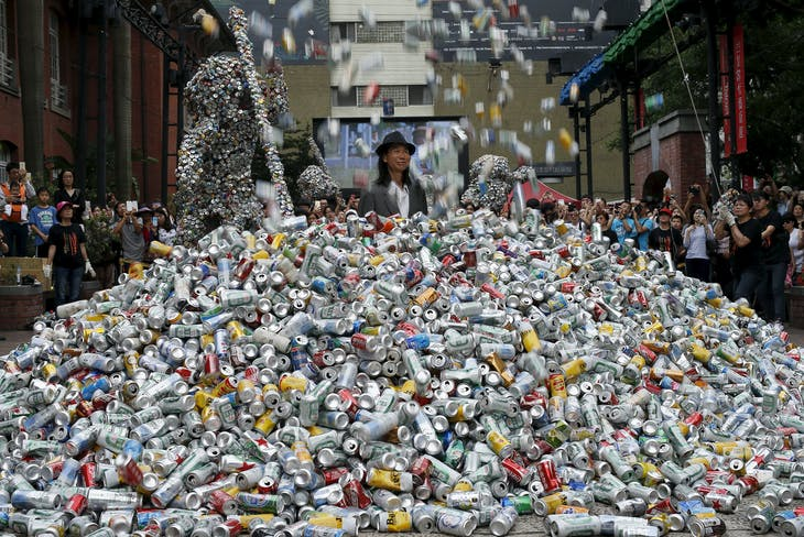 "Artist Chin Chih Yang performs ""Kill Me or Change"" with 30,000 cans falling and burying the artist underneath a mountain of garbage, at the Museum of Contemporary Art in Taipei, Taiwan April 23, 2016.  REUTERS/Tyrone Siu      TPX IMAGES OF THE DAY      - GF10000392994"